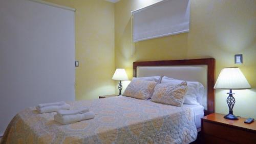 A bed or beds in a room at The Oaks Tamarindo