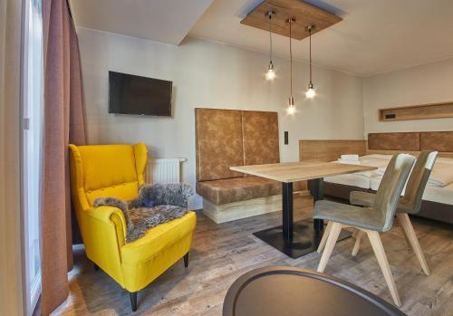 Coin salon dans l'établissement Appartement Casa Monte by HolidayFlats24