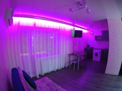 Телевизор и/или развлекательный центр в Apartment on Lenina 44