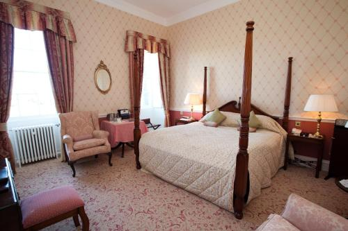 A bed or beds in a room at Culloden House Hotel
