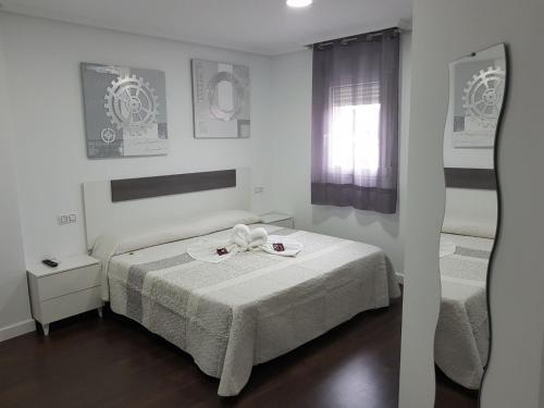 Cama o camas de una habitación en Hostal Goyesco Plaza