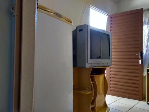 A television and/or entertainment center at Hotel Tangará