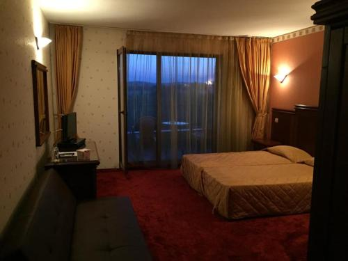 A bed or beds in a room at Boliari Hotel