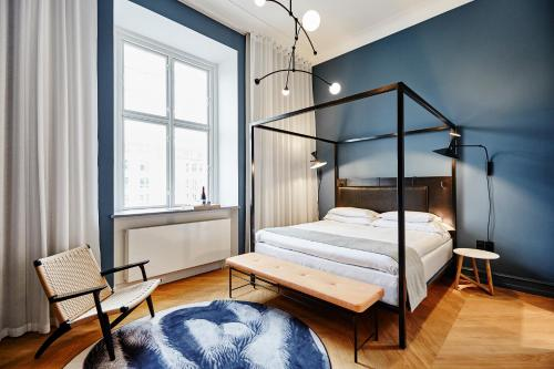 A bed or beds in a room at Nobis Hotel Copenhagen, a Member of Design Hotels™