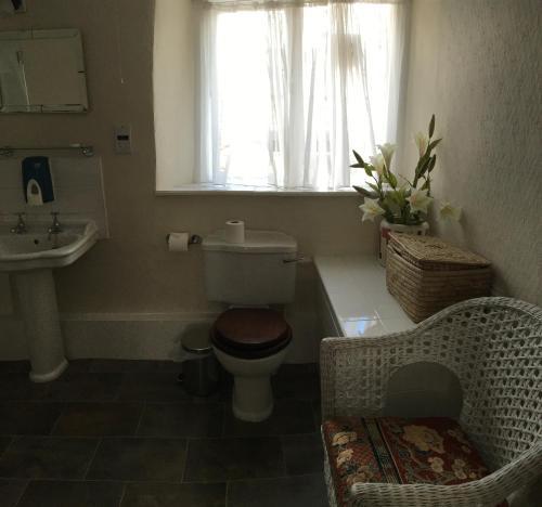 A bathroom at The Old Well Inn