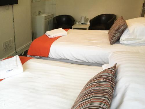 A bed or beds in a room at polygon guest house