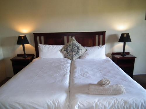 A bed or beds in a room at Thorn Tree Lodge & Conference Centre