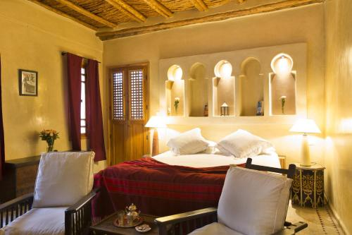 A bed or beds in a room at Riad Chbanate