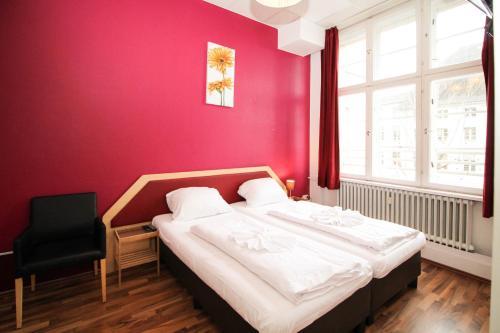 Ein Bett oder Betten in einem Zimmer der Unterkunft Metropol Hostel Berlin