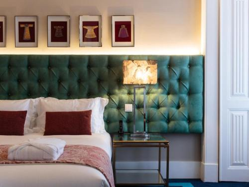 A bed or beds in a room at Dear Lisbon - Bordalo Palace Chiado