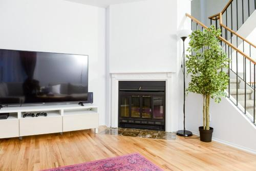 A television and/or entertainment center at JstLikeHome - Getaway