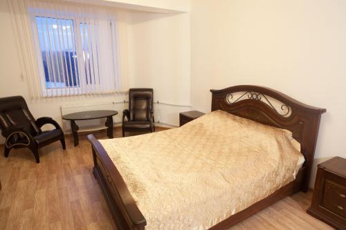 Кровать или кровати в номере Гостиница Вахромеево