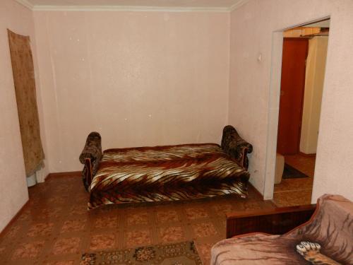 Кровать или кровати в номере 1-комн. квартира в Рыбинске на часы/сутки/недели