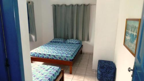 A bed or beds in a room at Presente do Mar