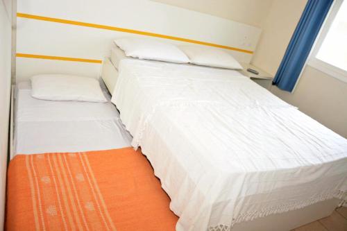 Cama ou camas em um quarto em Pousada Banana House