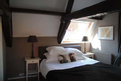 Een bed of bedden in een kamer bij Bed & Breakfast Adrichem en Scherpenseel