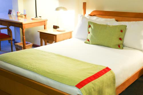 Cama o camas de una habitación en Presidente Suites Puerto Montt