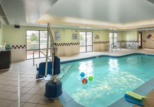 The swimming pool at or near SpringHill Suites by Marriott Charlotte Airport