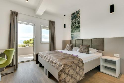 A bed or beds in a room at Rooms Rogač