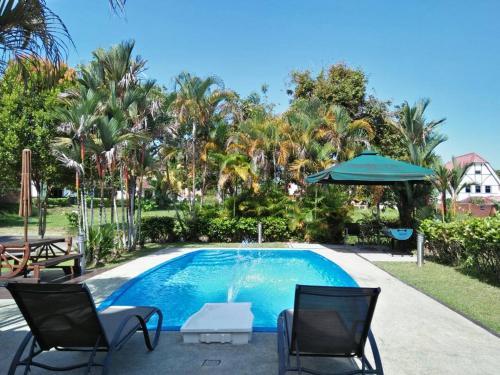 The swimming pool at or near Green Villa Famosa Alor Gajah