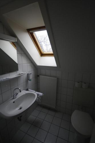 Ein Badezimmer in der Unterkunft Hotel-Gaststätte Mutter Buermann