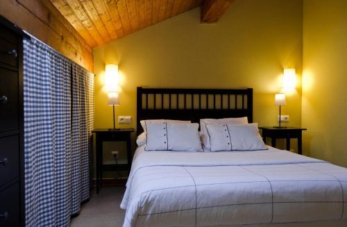 Cama o camas de una habitación en Apartamentos Playa Galizano
