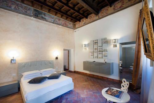 Un ou plusieurs lits dans un hébergement de l'établissement Navona Luxury Apartments