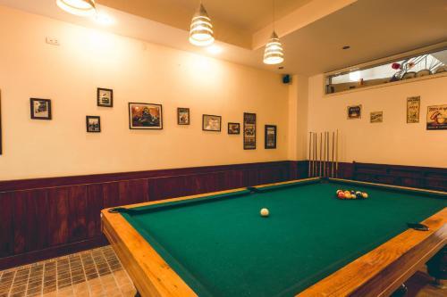 A billiards table at The HillSide Homestay Hue
