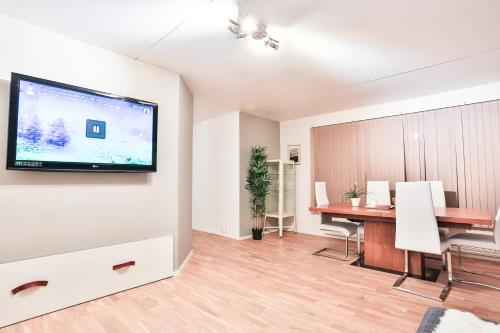 A television and/or entertainment center at Fredrik's apartment in Oslo centre
