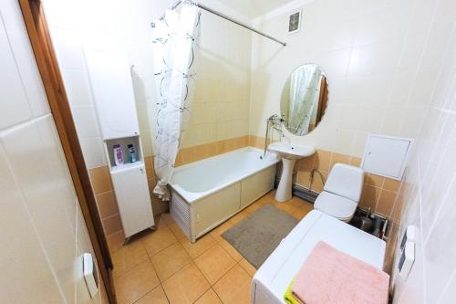 A bathroom at Apartment in Center on Malysheva