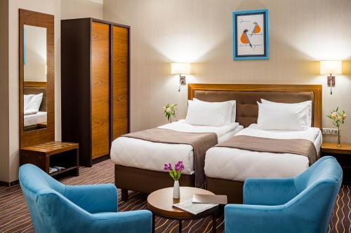 Ліжко або ліжка в номері Taurus City Hotel