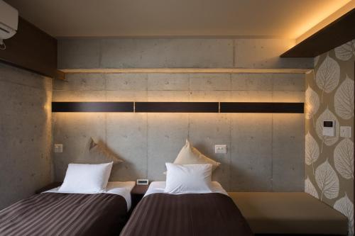 コンドミニオ マキシ アネッソにあるベッド