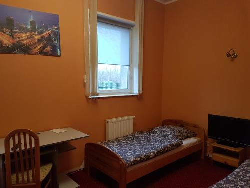 Кровать или кровати в номере Chrobry