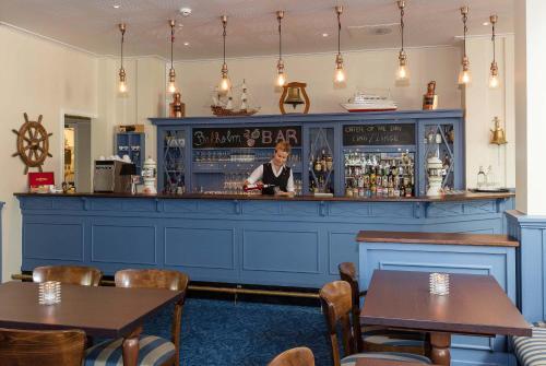 Lounge oder Bar in der Unterkunft Kviknes Hotel
