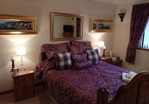 A bed or beds in a room at One Strathview B&B