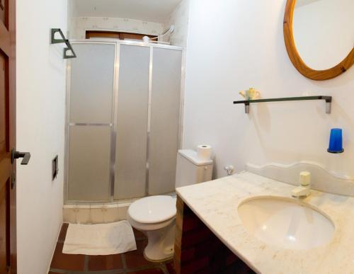 Um banheiro em Thalassa Pousada