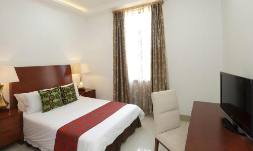 A bed or beds in a room at President Hotel at Umodzi Park
