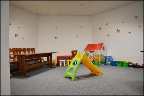 Herní místnost nebo prostor pro děti v ubytování Penzion Starý dvůr