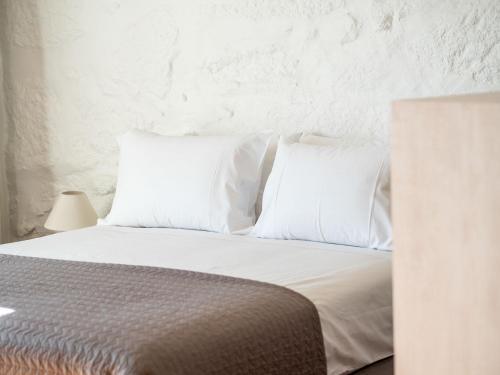 Uma cama ou camas num quarto em Casa Carolina