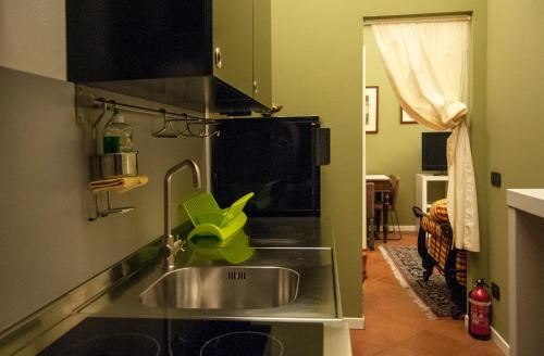 A kitchen or kitchenette at A Casa Di Paola Suite