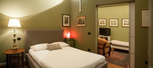 A bed or beds in a room at A Casa Di Paola Suite