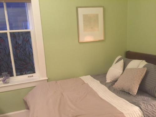 A bed or beds in a room at Wicker Park Apartment Near Division Blue Line