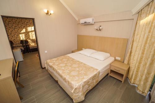 Кровать или кровати в номере Отель «Антика»
