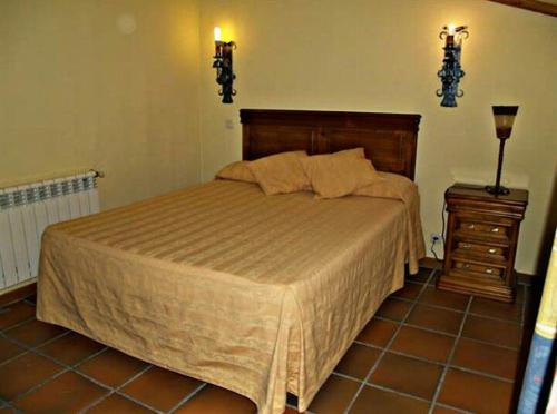 Кровать или кровати в номере Hostal restaurante Villa de Sepúlveda