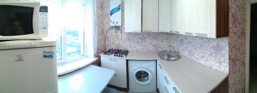 "A kitchen or kitchenette at ""Малая Земля"" (Проспект Ленина/ Героев Десантников)"