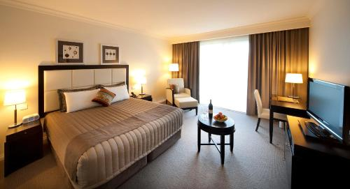 A bed or beds in a room at Century Inn
