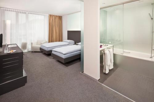 A bed or beds in a room at INNSiDE by Meliá Düsseldorf Derendorf
