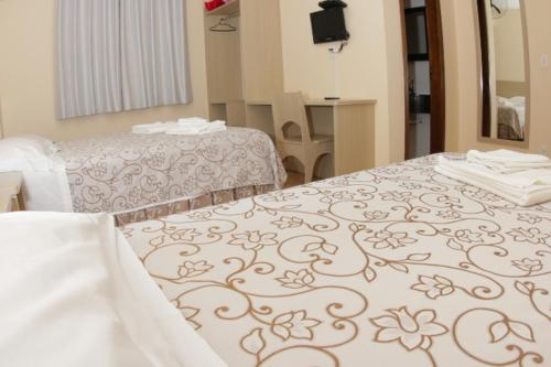 A bed or beds in a room at Hotel Turella