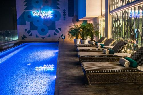 The swimming pool at or near Square Small Luxury Hotel