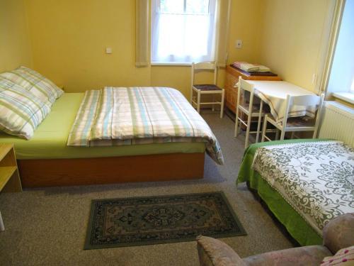 Postel nebo postele na pokoji v ubytování Pension Ingrid